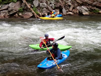 People in kayak on Nantahala River at NOC.